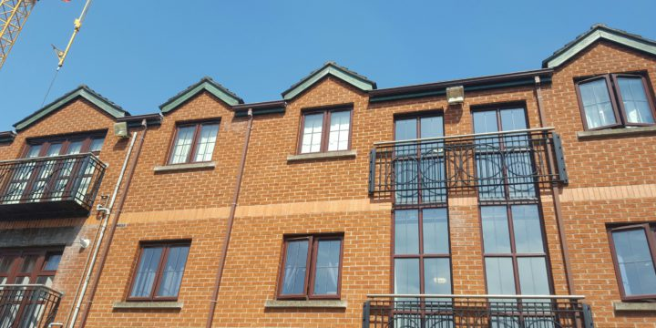 Brown upvc fascia boards and guttering installed