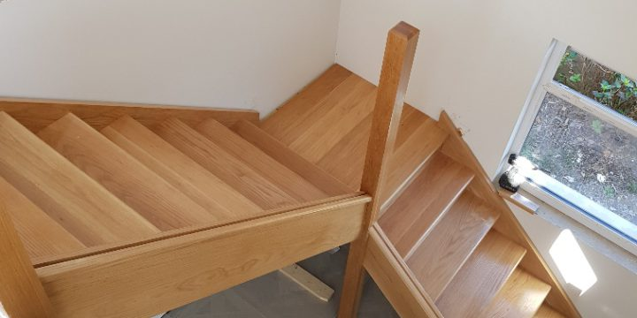 Oak staircase made and fitted for glass panels in Cultra